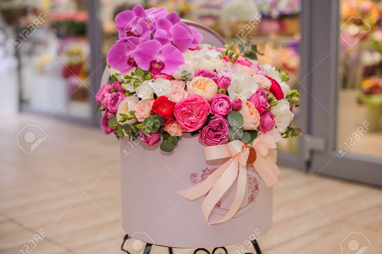 Big Bright Pink Flower Bouquet In Round Box With Lid Stock Photo
