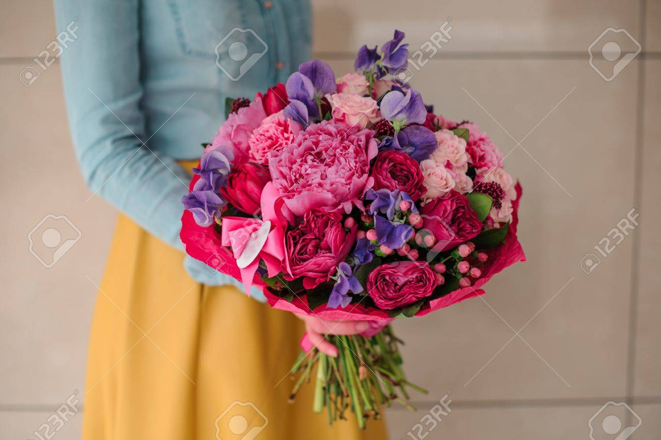 Girl holding bouquet of a mixed pink and purple flowers no face girl holding bouquet of a mixed pink and purple flowers no face stock photo 60557533 izmirmasajfo
