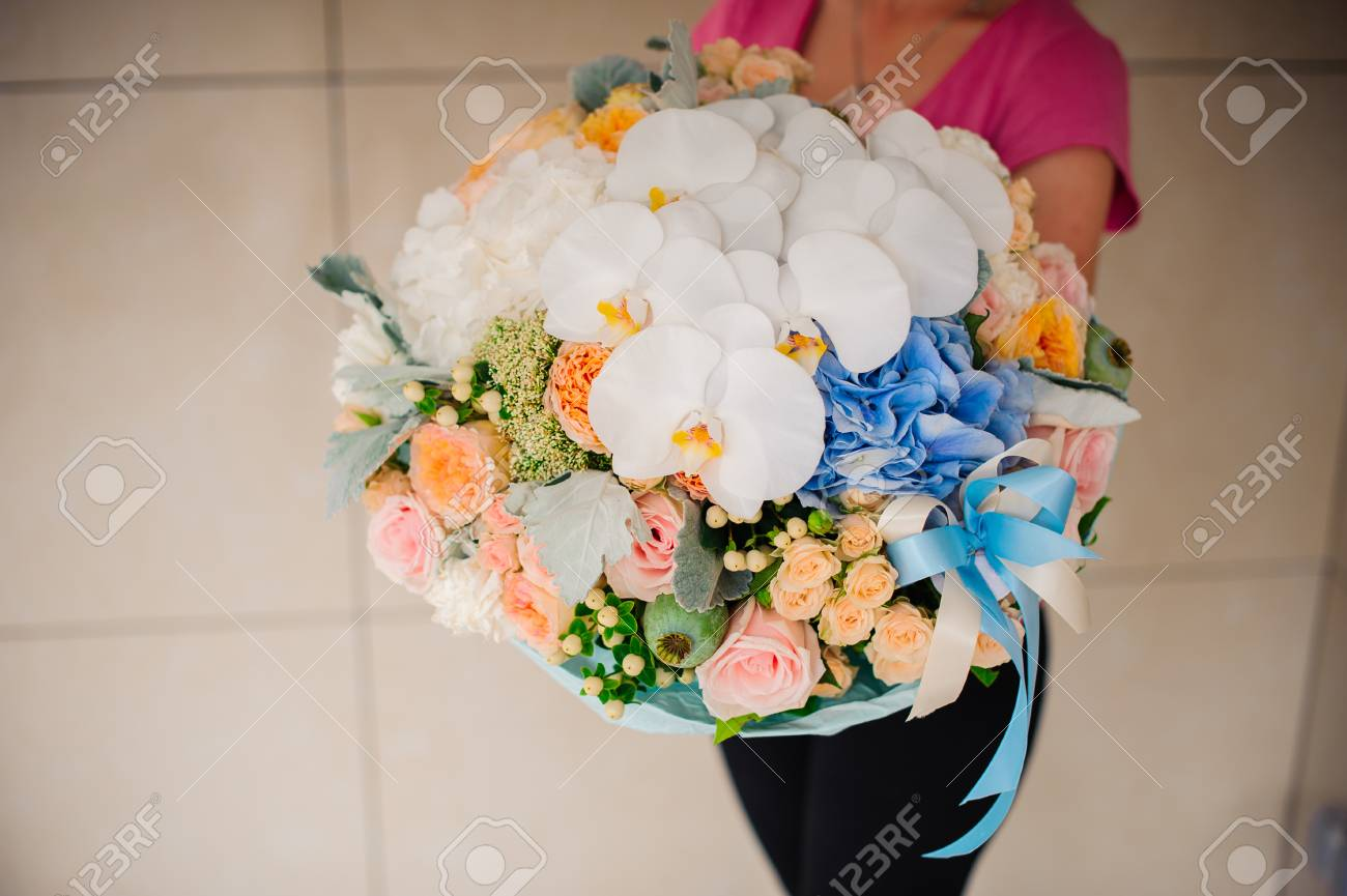 Girl Holding Beautiful Mix Flower Bouquet With Big White Orchid ...