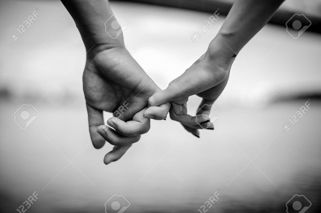 Happy couple holding hands black and white stock photo 64370443
