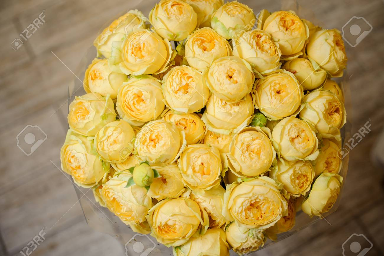 Very Beautiful Bouquet Of Bright Yellow Flowers On The Grey