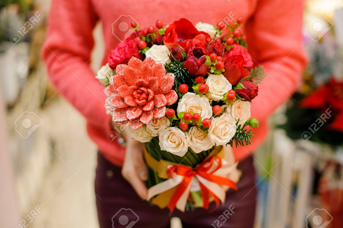 Little And Pretty Winter Bouquet Of Red Flowers In Woman Hands