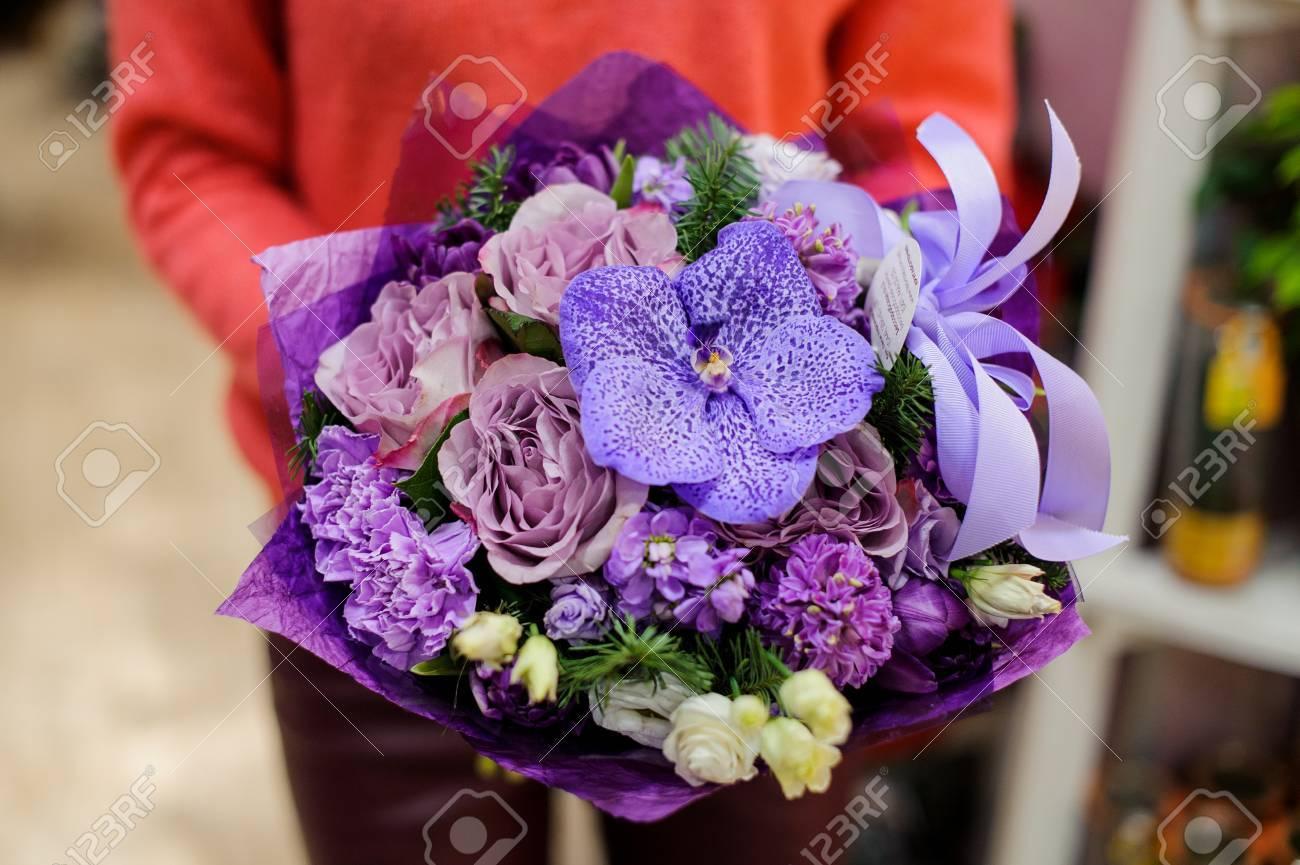 Amazing purple winter bouquet of beautiful flowers in woman hands amazing purple winter bouquet of beautiful flowers in woman hands no face close up izmirmasajfo