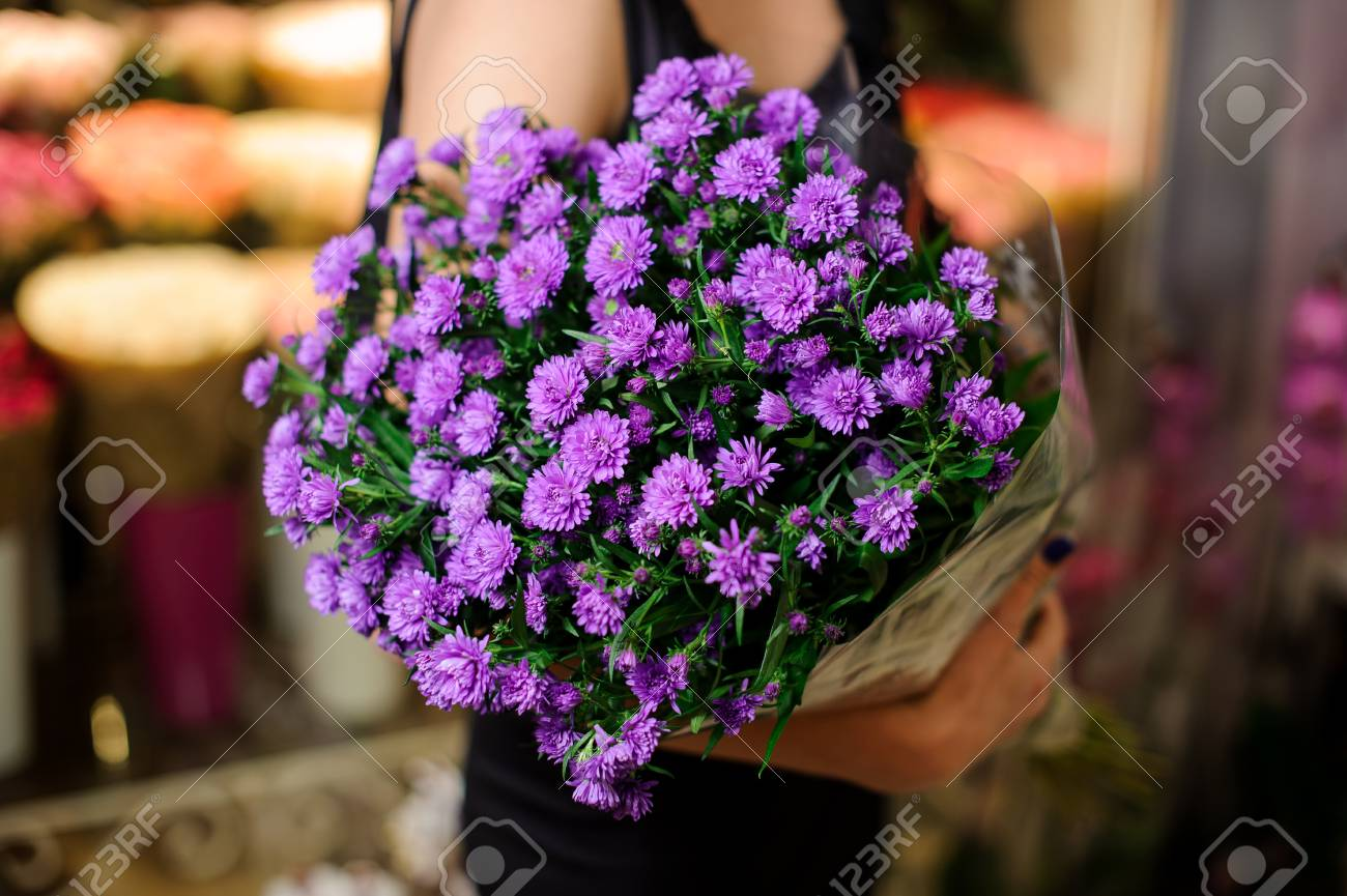 Elegant And Beautiful Bouquet Of Little Purple Flowers In Woman ...