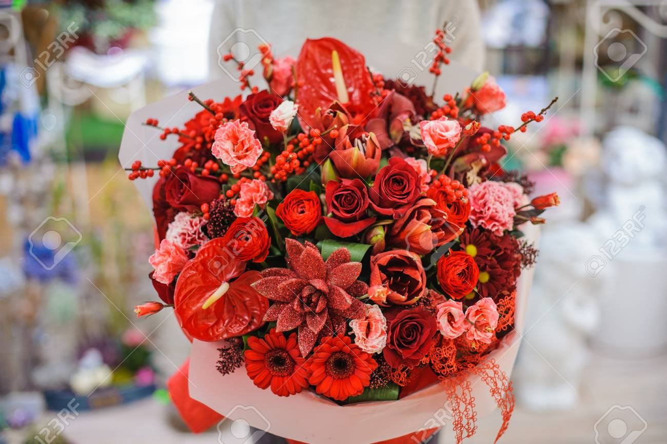 Bright And Gorgeous Bouquet Of Lovely Red Flowers In Woman Hands ...
