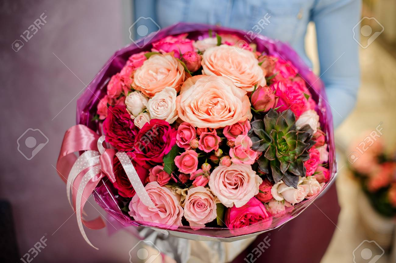 Large And Gorgeous Pink Bouquet Of Flowers In Womans Hands On