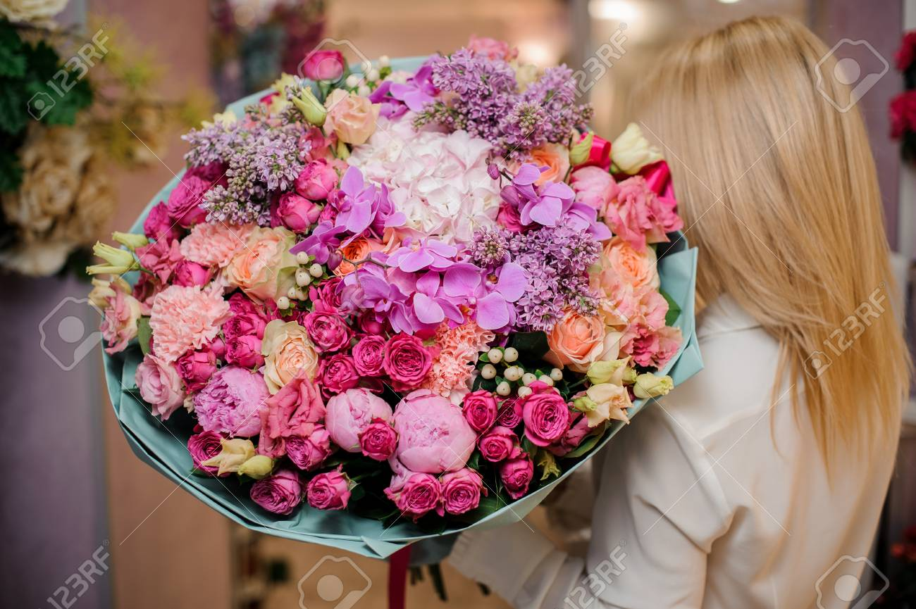 Back View Of A Blonde Girl With A Large And Colorful Bouquet.. Stock ...