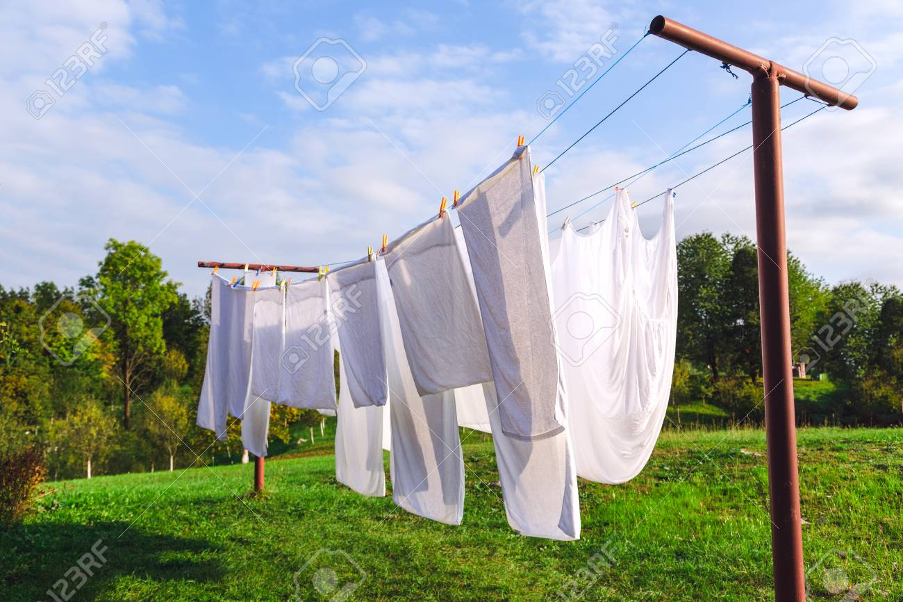 Fresh Clean White Sheet Drying On Washing Line In Outdoor Stock Photo Picture And Royalty Free Image Image 94206416