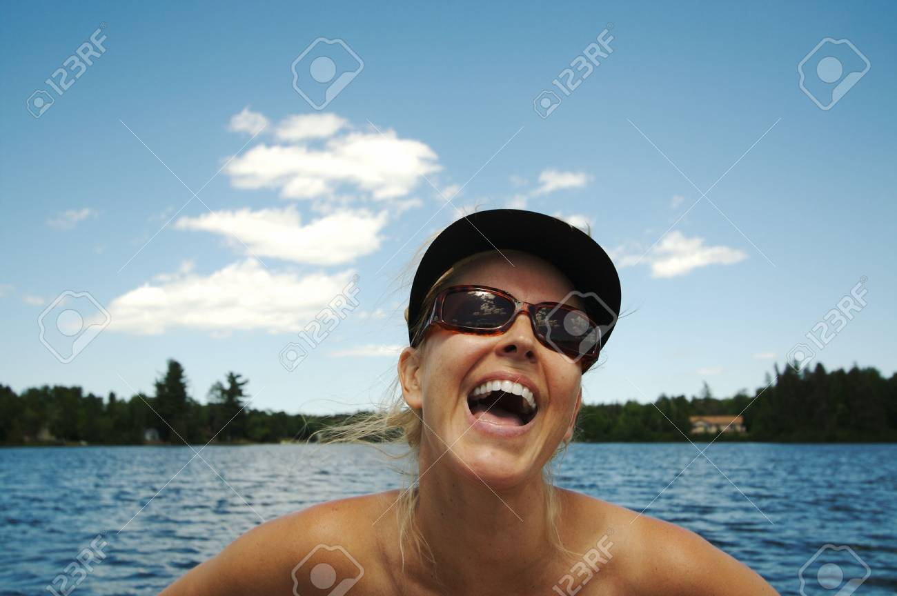 Beautiful woman enjoys a summer day on the lake. Stock Photo - 1282204