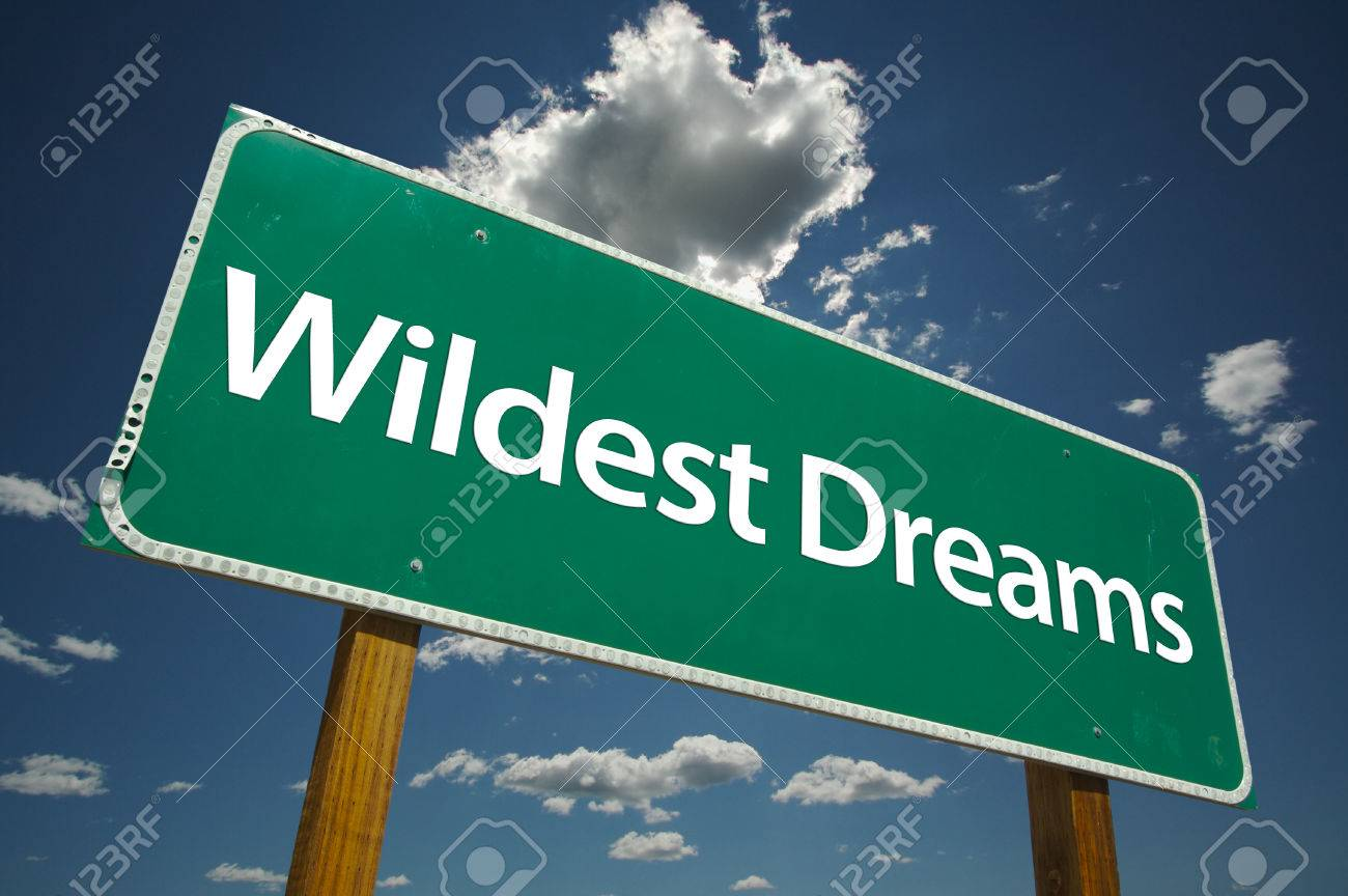 Wildest Dreams road sign with dramatic clouds and sky. Stock Photo - 1479804