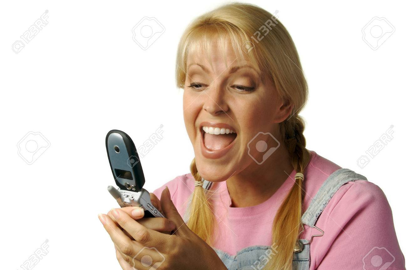 Happy Girl Laughs While Texting with Cell Phone Stock Photo - 1479740