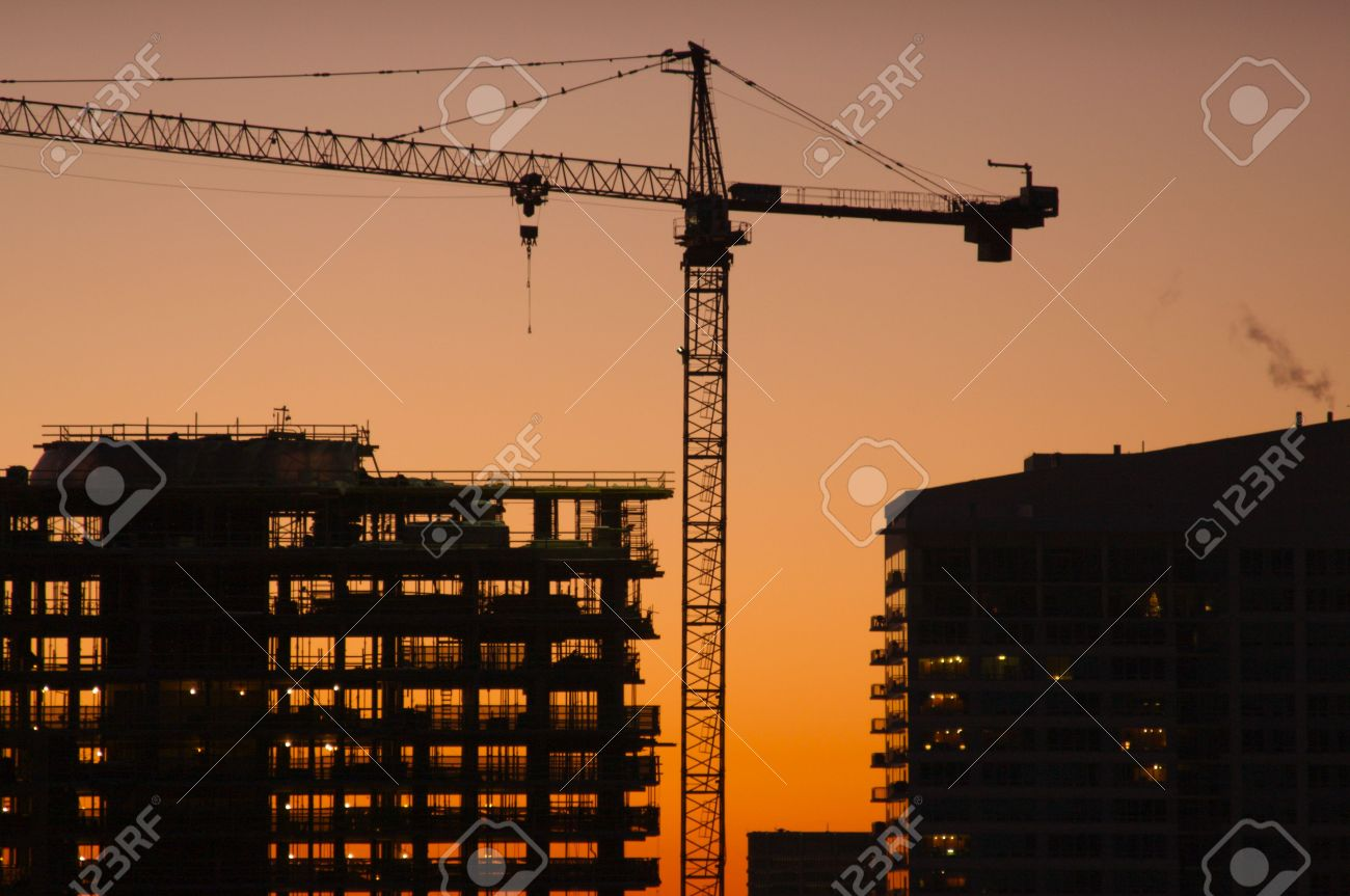 Silhouette of Crane and Building Construction Site Stock Photo - 2392230