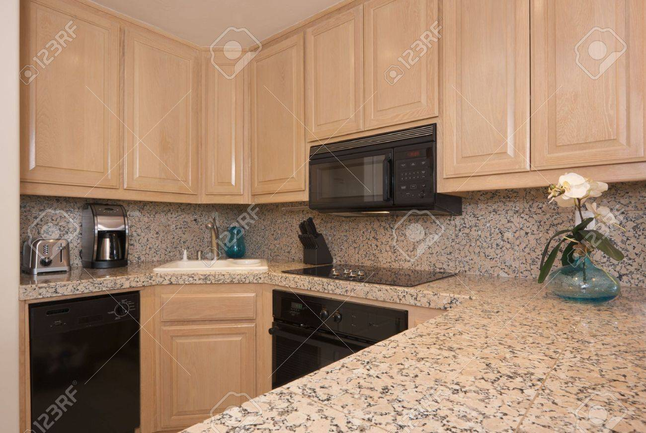 modern kitchen interior with marble countertop. stock photo