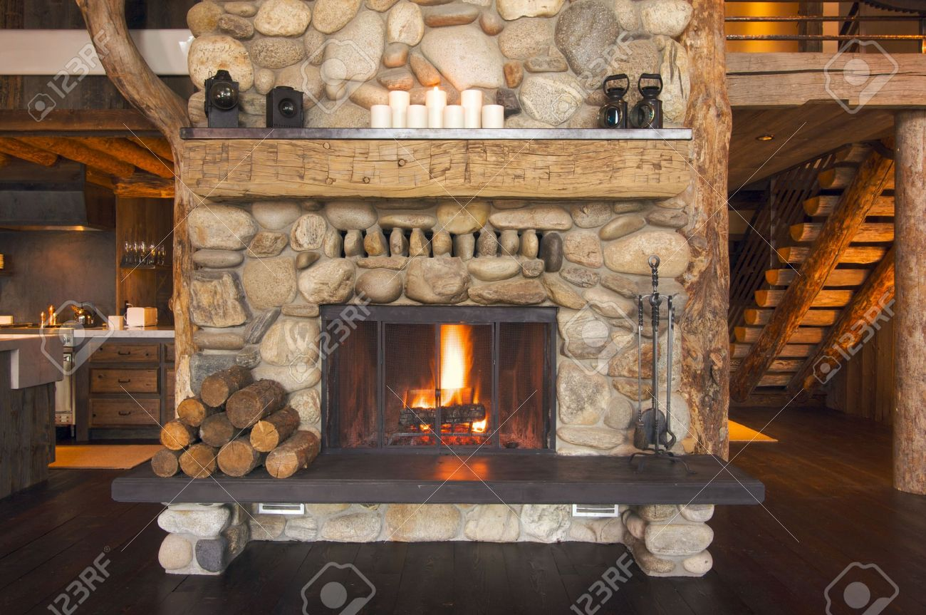 Rustic Fireplace In Log Cabin Stock Photo Picture And Royalty Free Image Image 3714384