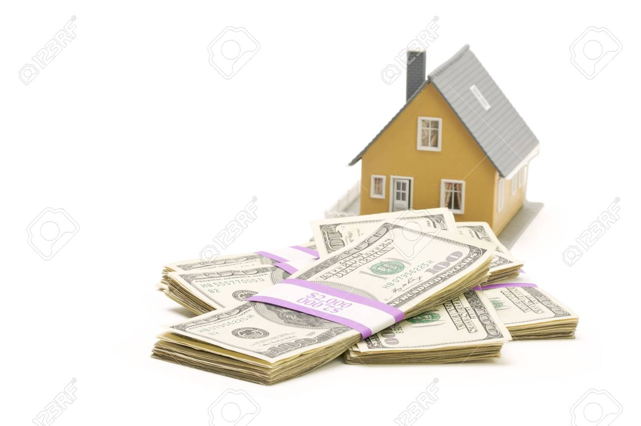 Home and Stacks of Money Isolated on a White Background Stock Photo - 3879233
