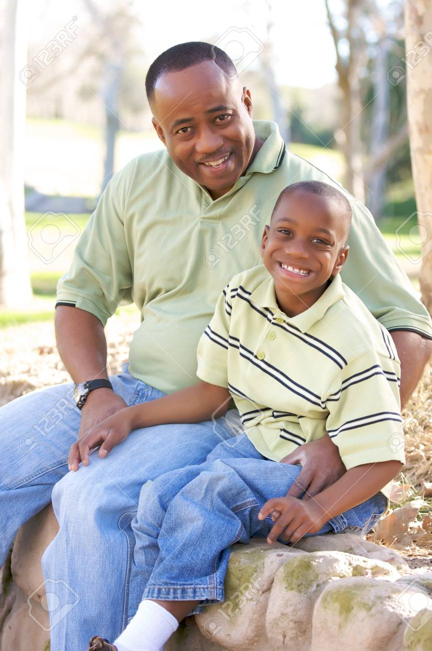 Man and Child Having fun in the park. Stock Photo - 4127365