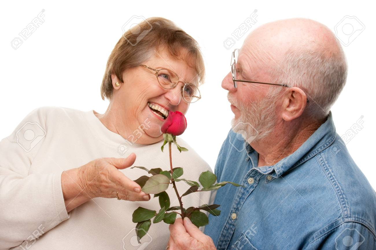 Happy Senior Couple with Red Rose Isolated on a White Background. Stock Photo - 4176229