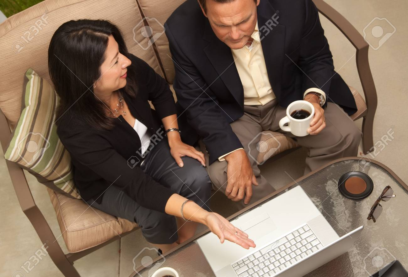 Man and Woman Using Laptop with Coffee Stock Photo - 5021989