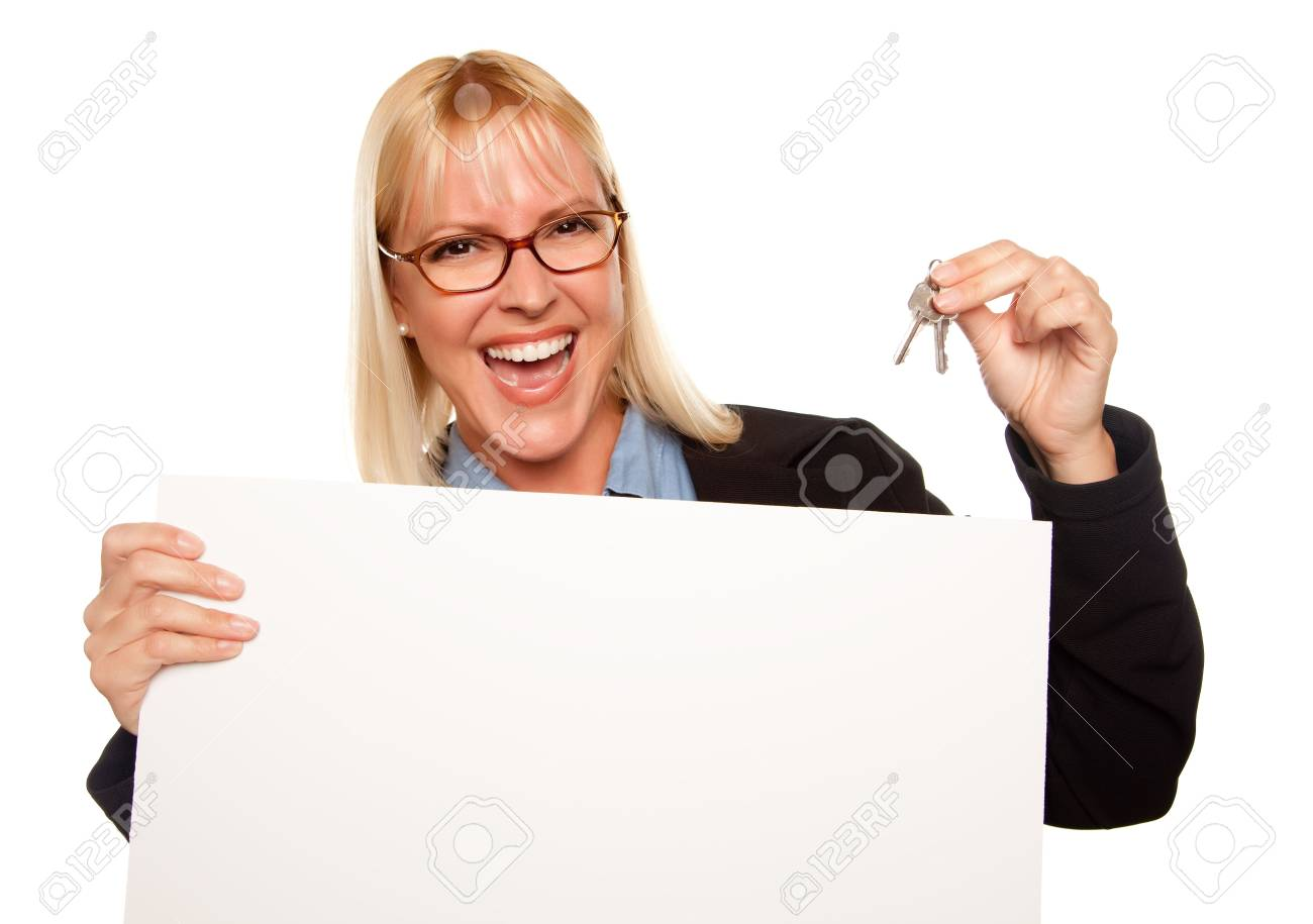 Attractive Blonde Holding Keys and Blank White Sign Isolated on a White Background. Stock Photo - 5620880