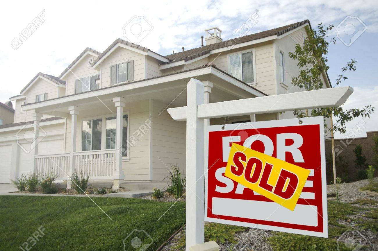 Sold Home For Sale Sign in Front of Beautiful New House. Stock Photo - 5777705