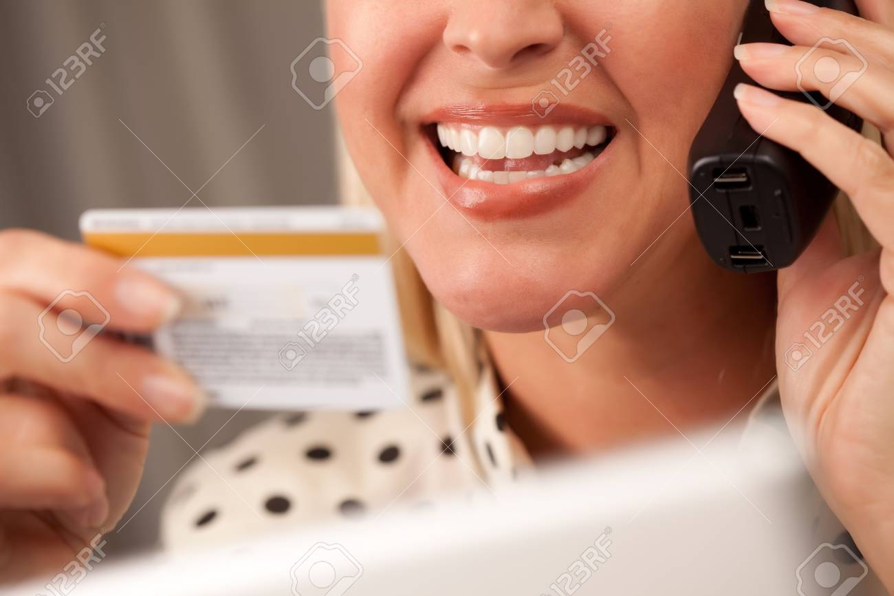 Beautiful Woman on the Phone Holding Her Credit Card. Stock Photo - 5925067