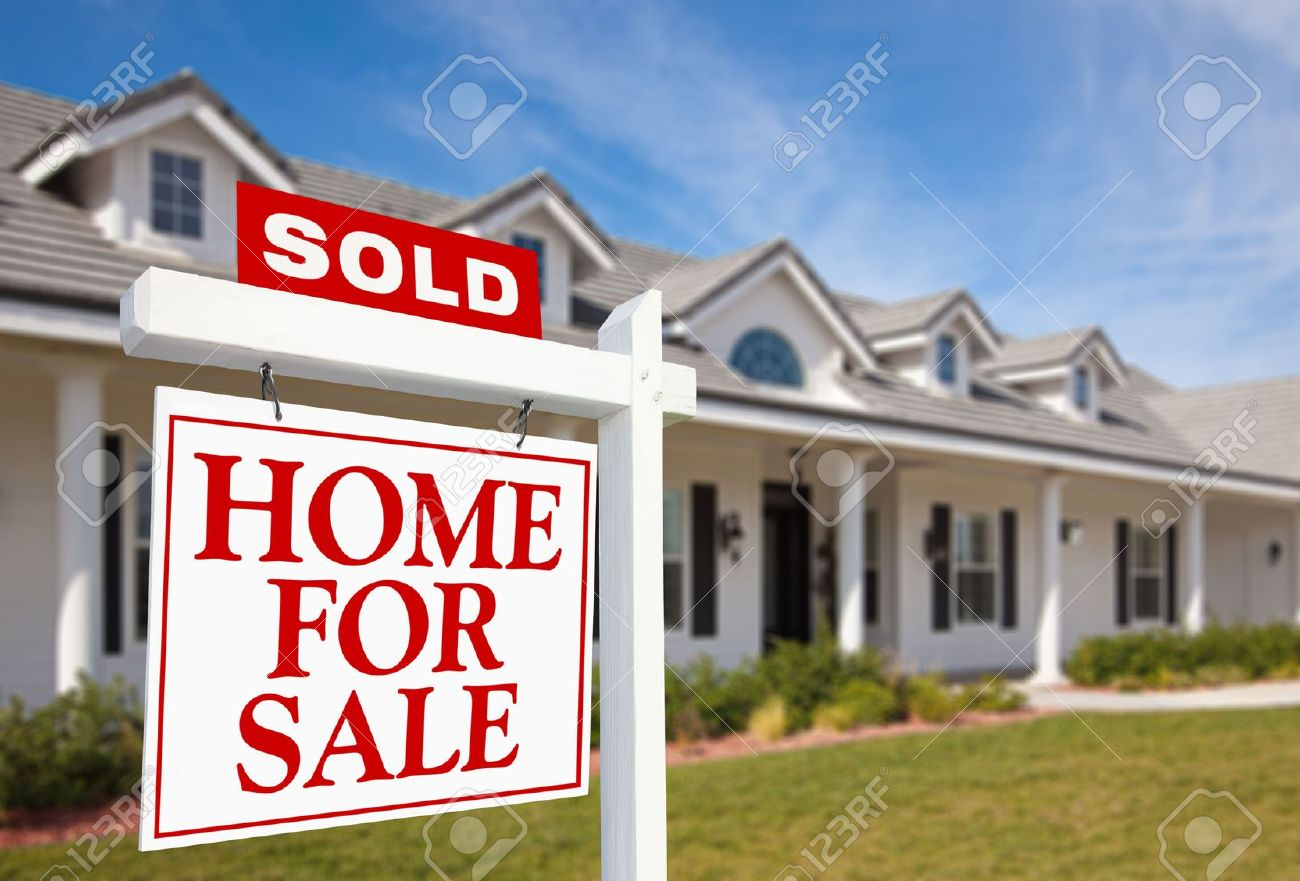 Sold Home For Sale Sign in front of Beautiful New Home. Stock Photo - 6028682