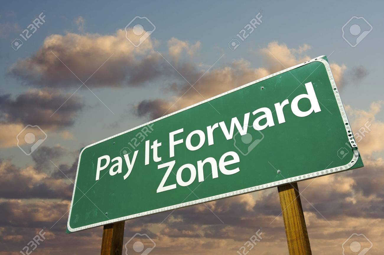 Pay It Forward Zone Green Road Sign In Front of Dramatic Clouds and Sky. Stock Photo - 6568841