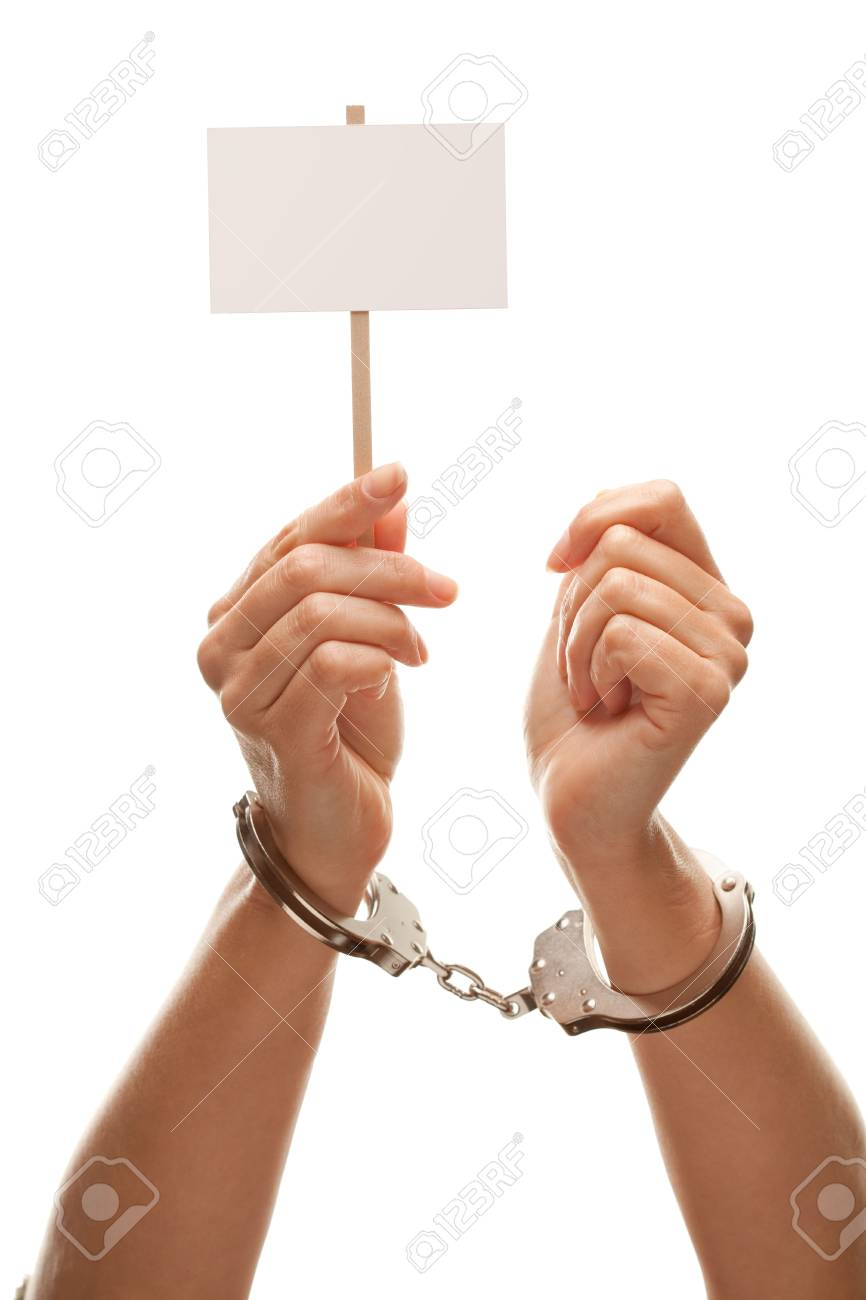 Handcuffed Woman Holding Blank White Sign Isolated on a White Background - Ready for Your Own Message. Stock Photo - 6607704