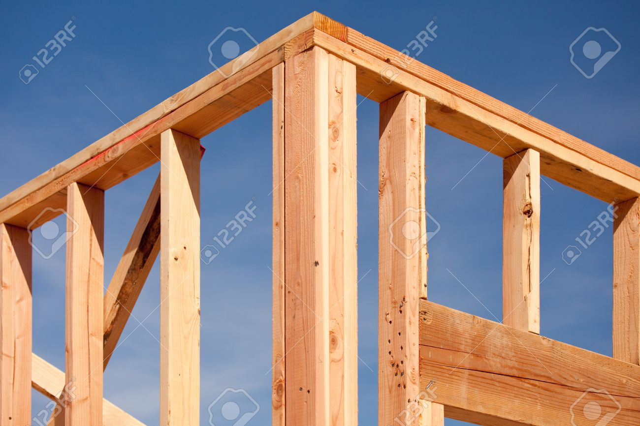 new residential home construction framing site against blue sky stock photo 6971220