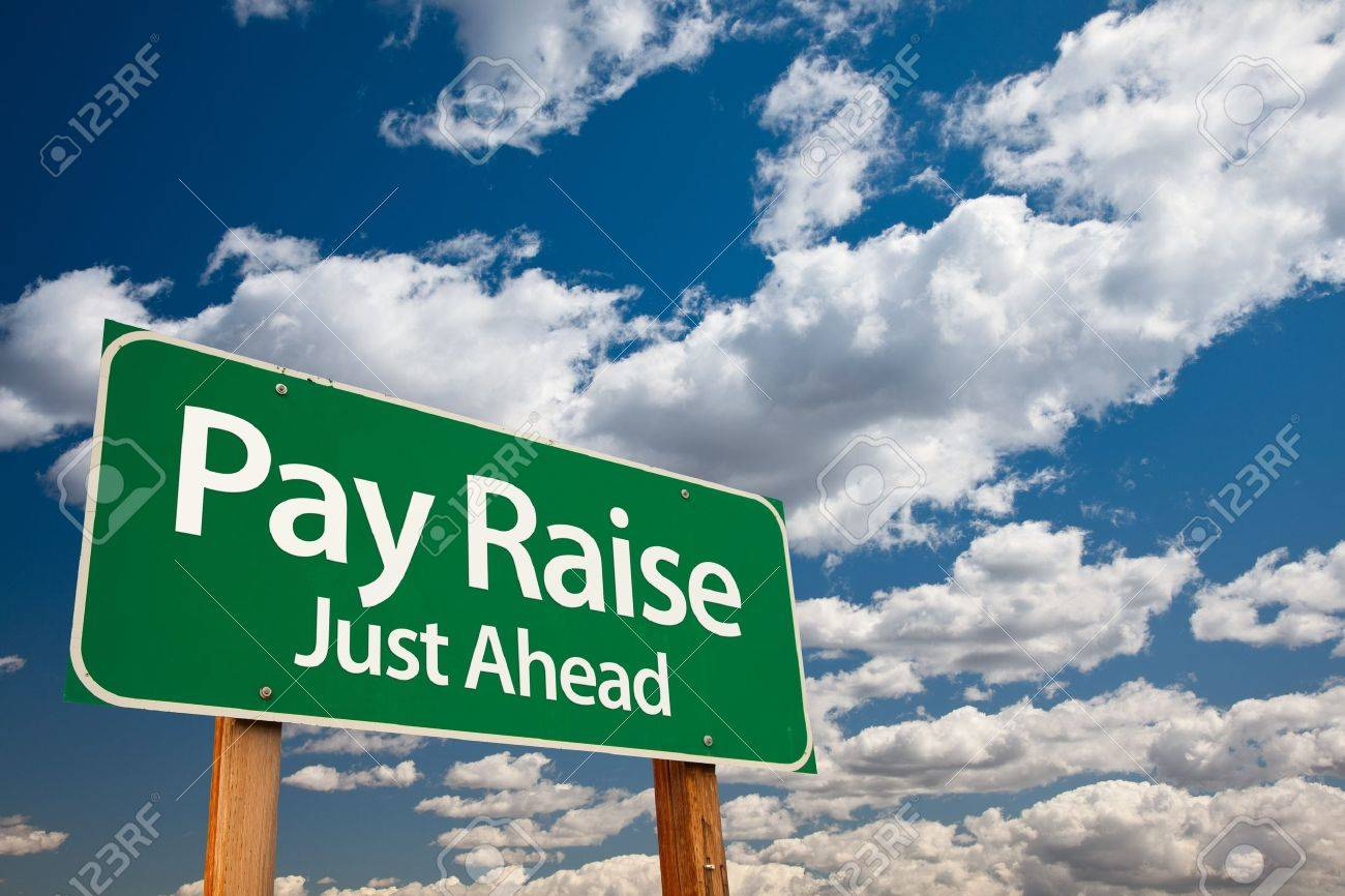 pay raise just ahead green road sign copy room over the pay raise just ahead green road sign copy room over the dramatic clouds and