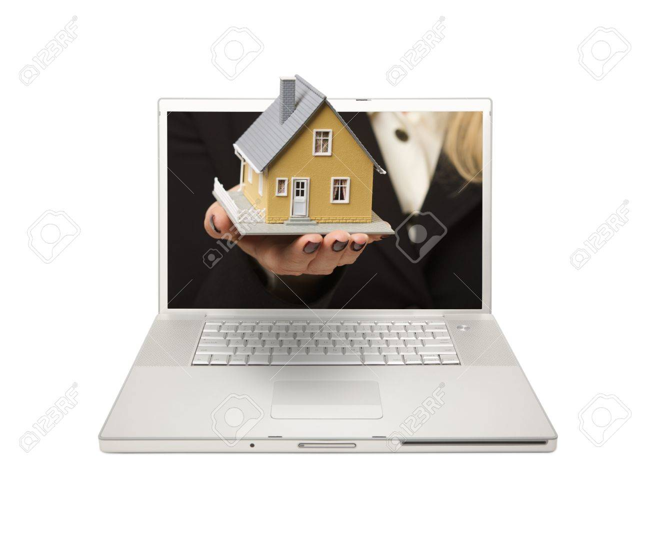 Woman Handing House Through Laptop Screen Isolated on a White  Background. Stock Photo - 7086925