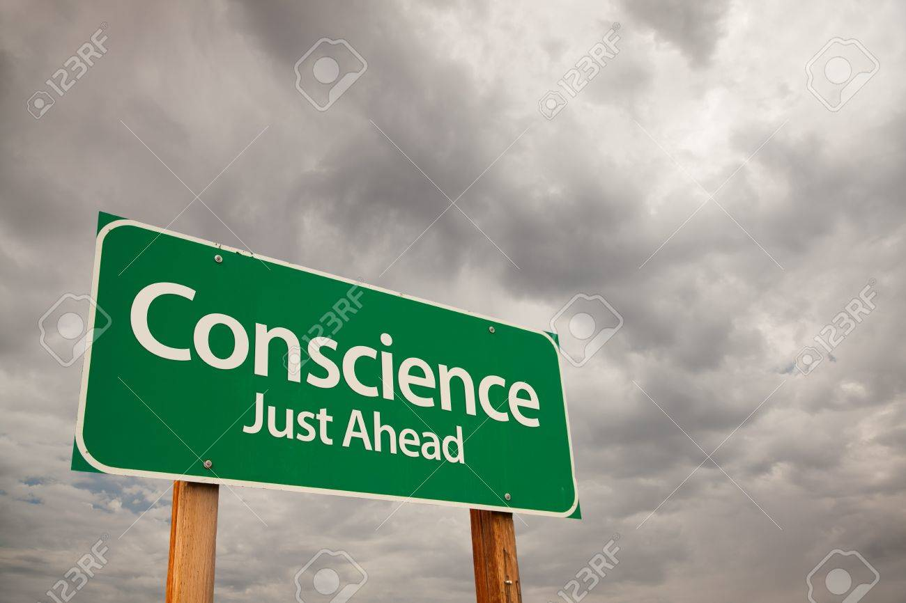 Conscience Just Ahead Green Road Sign with Dramatic Storm Clouds and Sky. Stock Photo - 7374818