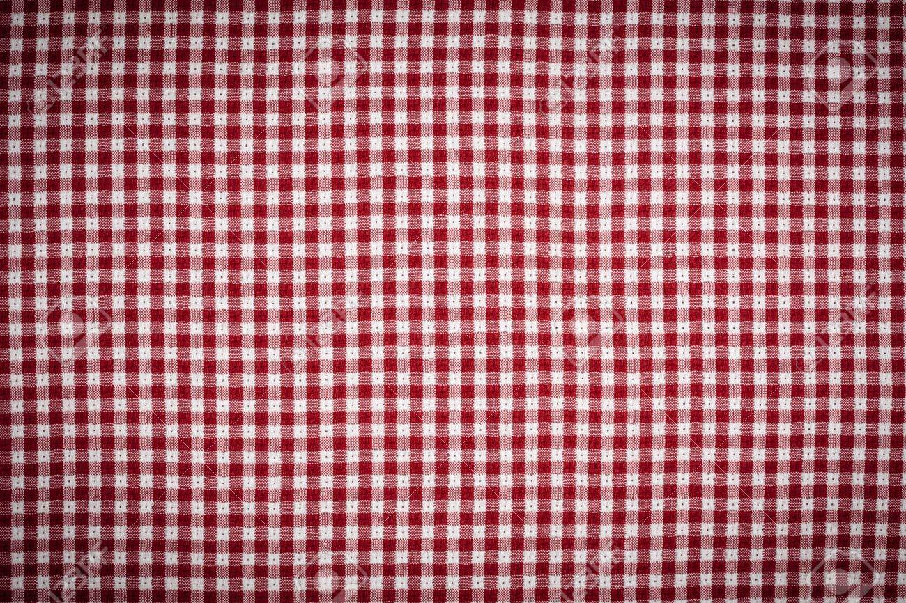 Red and White Gingham Checkered Picnic Blanket Tablecloth Background with Vignette. Stock Photo - 7652521