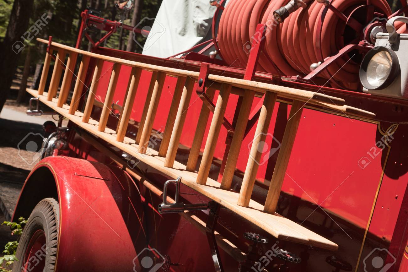 Vintage Red Fire Truck with Latter and Hose. Stock Photo - 7652513