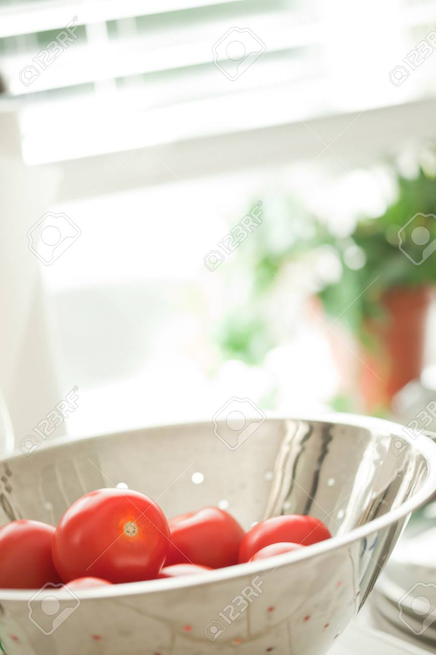 Macro of Fresh, Vibrant Roma Tomatoes in Colander with Water Drops Abstract. Stock Photo - 7652510