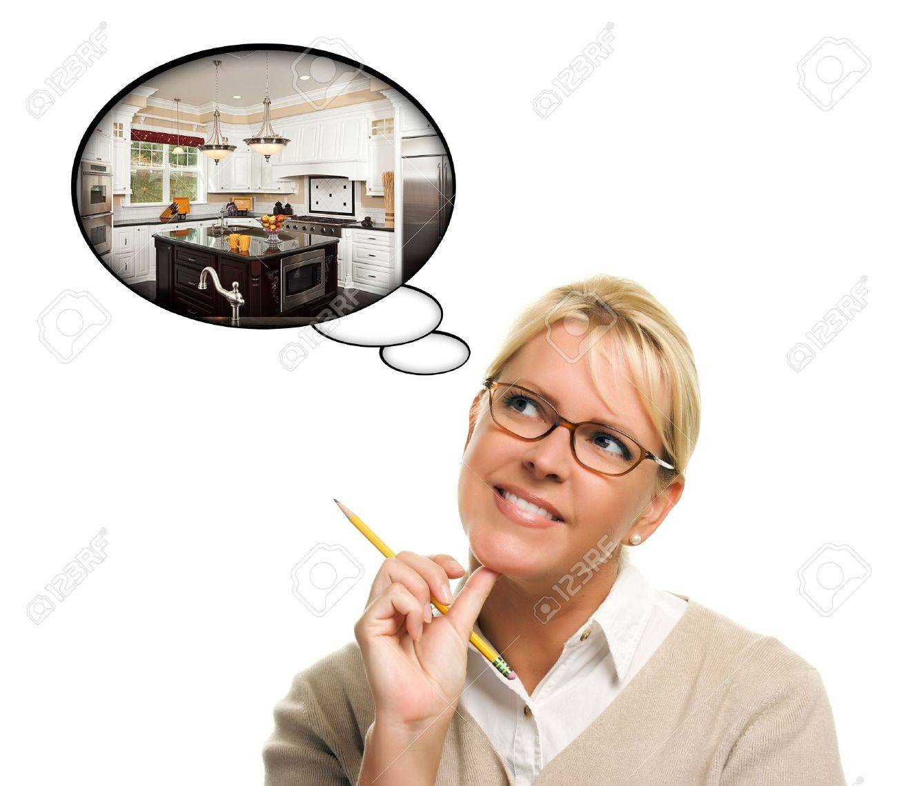 Woman with Thought Bubbles of a New Kitchen Design Isolated on a White Background. Stock Photo - 7872975
