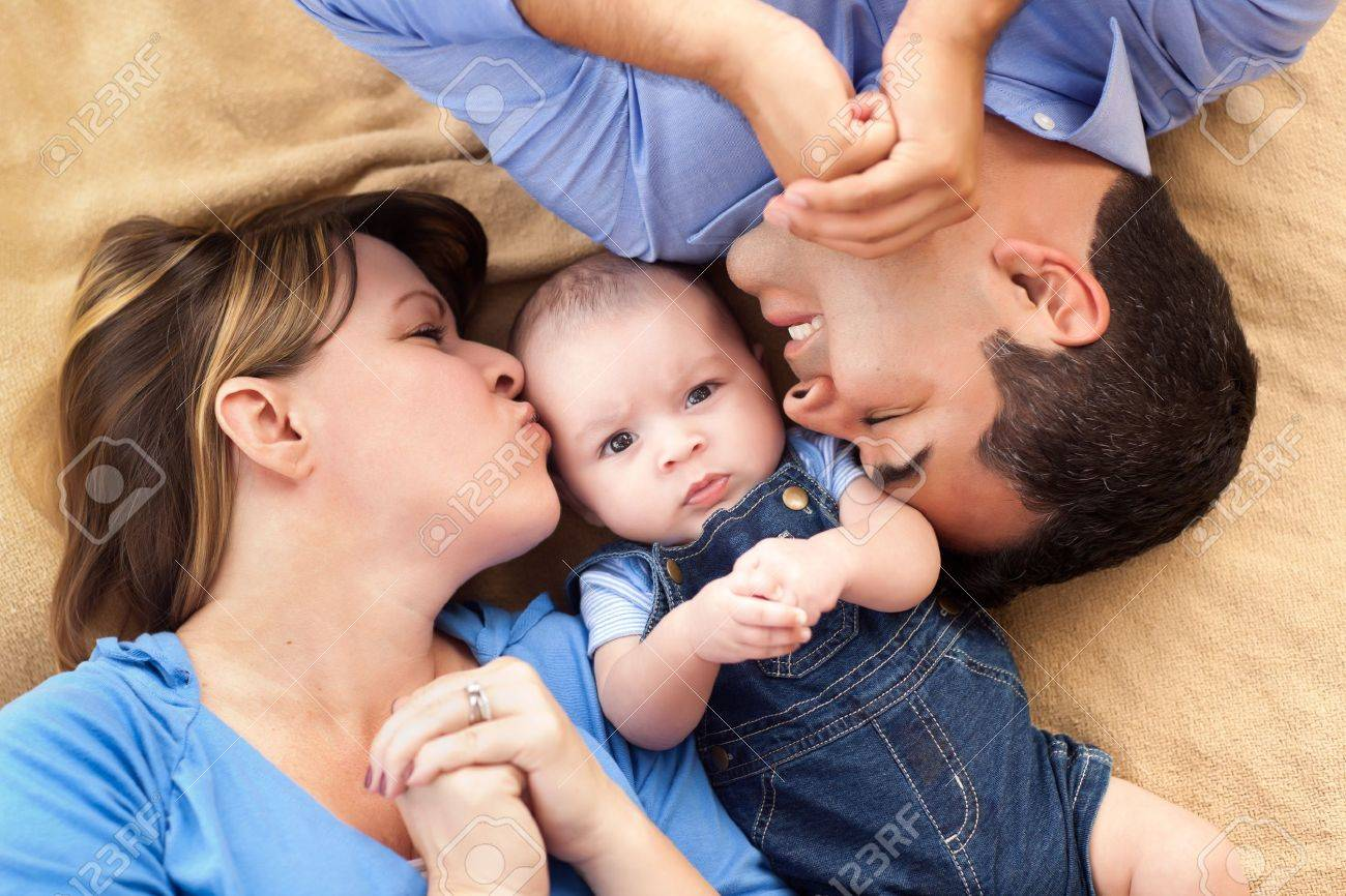 Mixed Race Family Playing Face Up on the Blanket. Stock Photo - 8253346