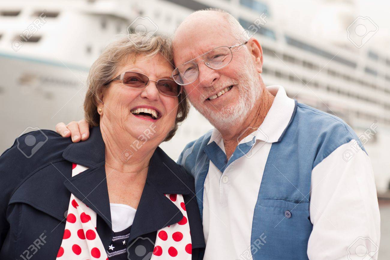 Senior Couple On Shore in Front of Cruise Ship While on Vacation. Stock Photo - 8644016