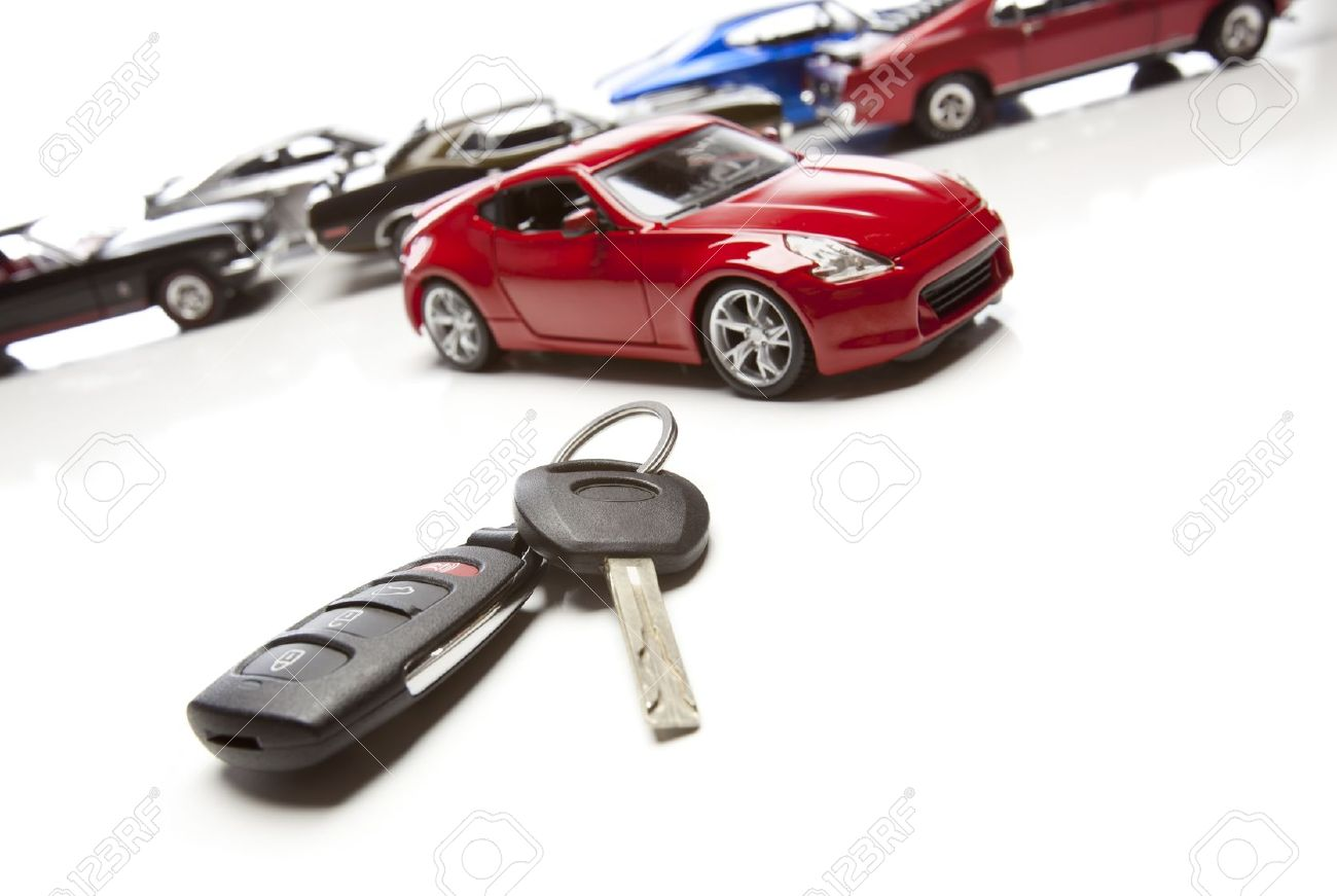 Car Keys And Several Sports Cars On White Background Stock Photo