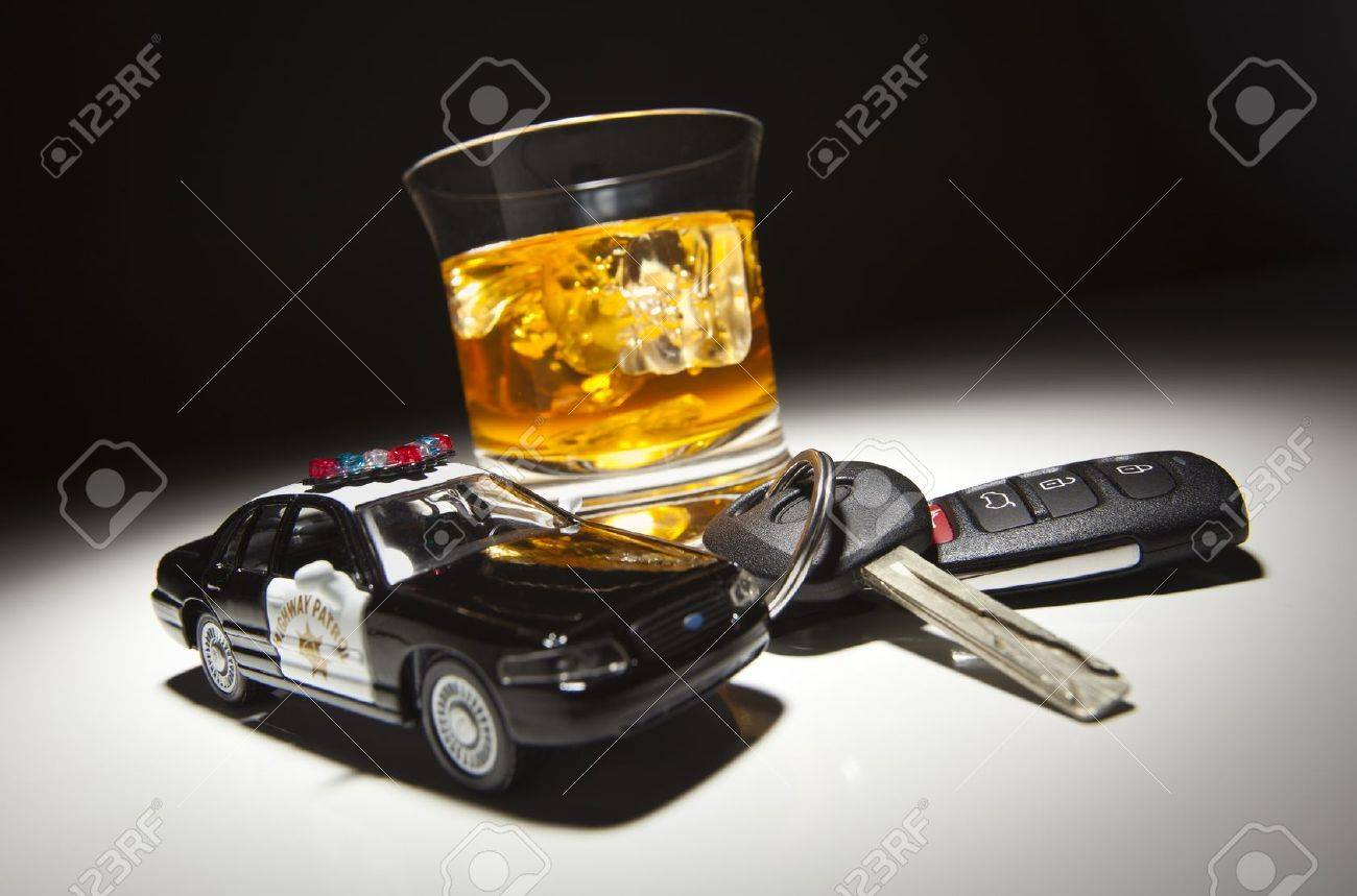 Highway Patrol Police Car Next to Alcoholic Drink and Keys Under Spot Light. Stock Photo - 9248912