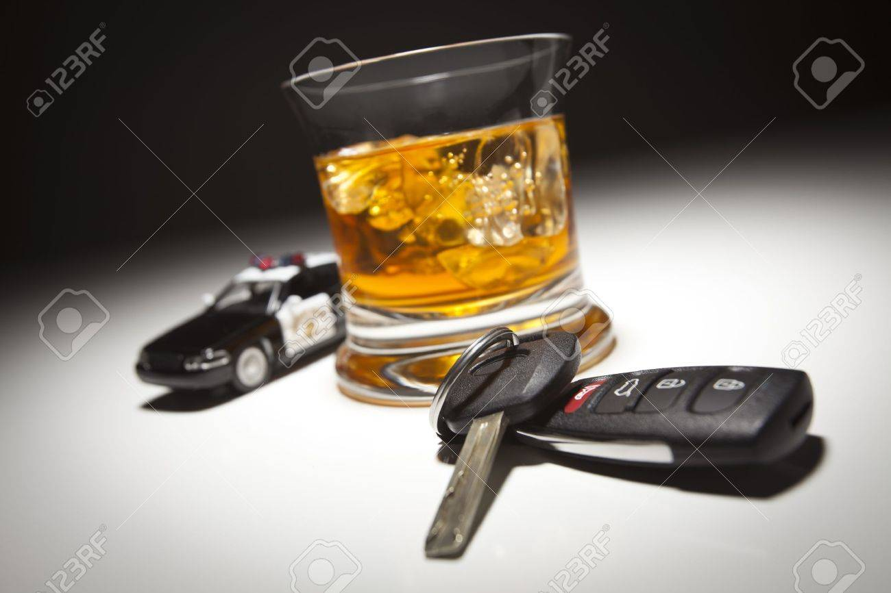 Highway Patrol Police Car Next to Alcoholic Drink and Keys Under Spot Light. Stock Photo - 9248919