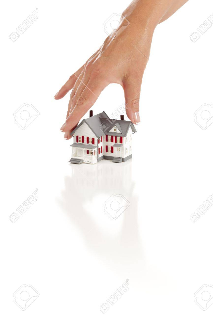 Womans Hand Choosing A Home on a White Background. Stock Photo - 9643216