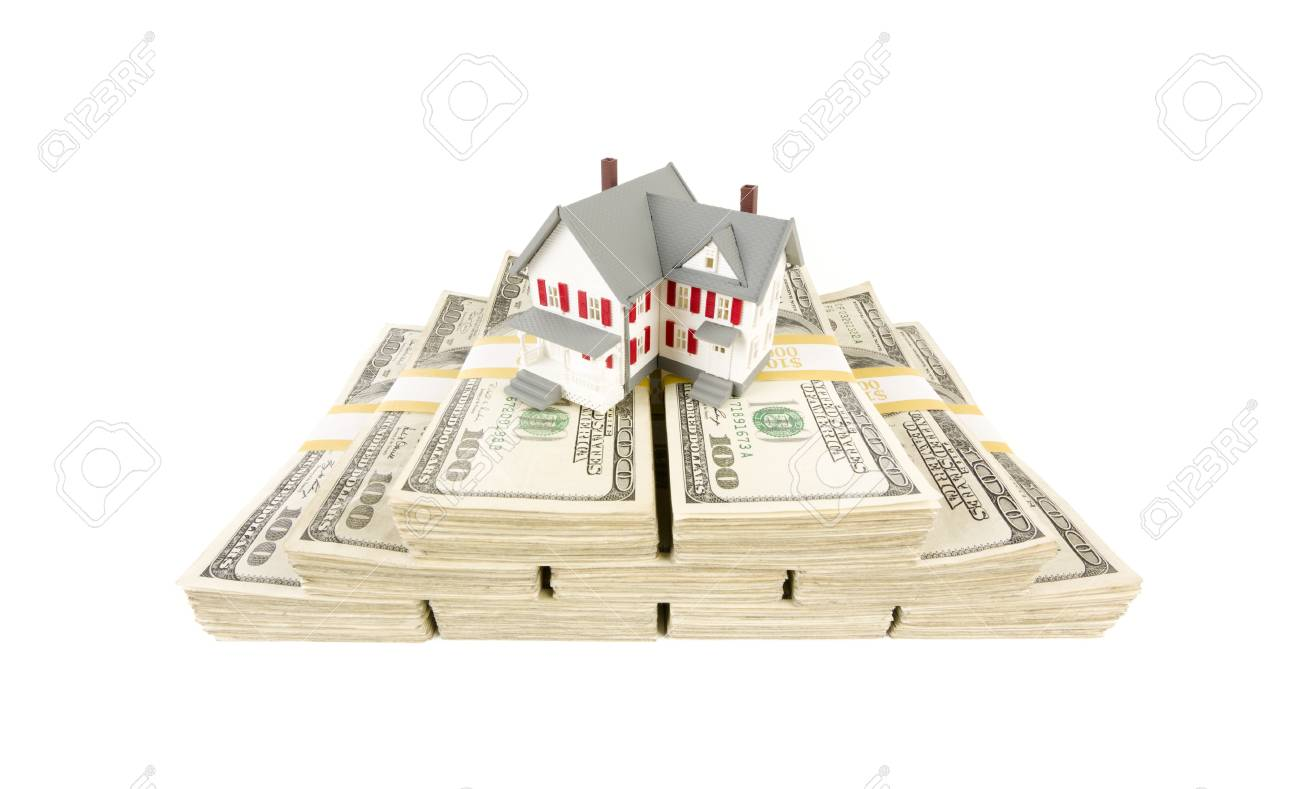 Small House on Stacks of Hundred Dollar Bills Isolated on a White Background. Stock Photo - 9923579