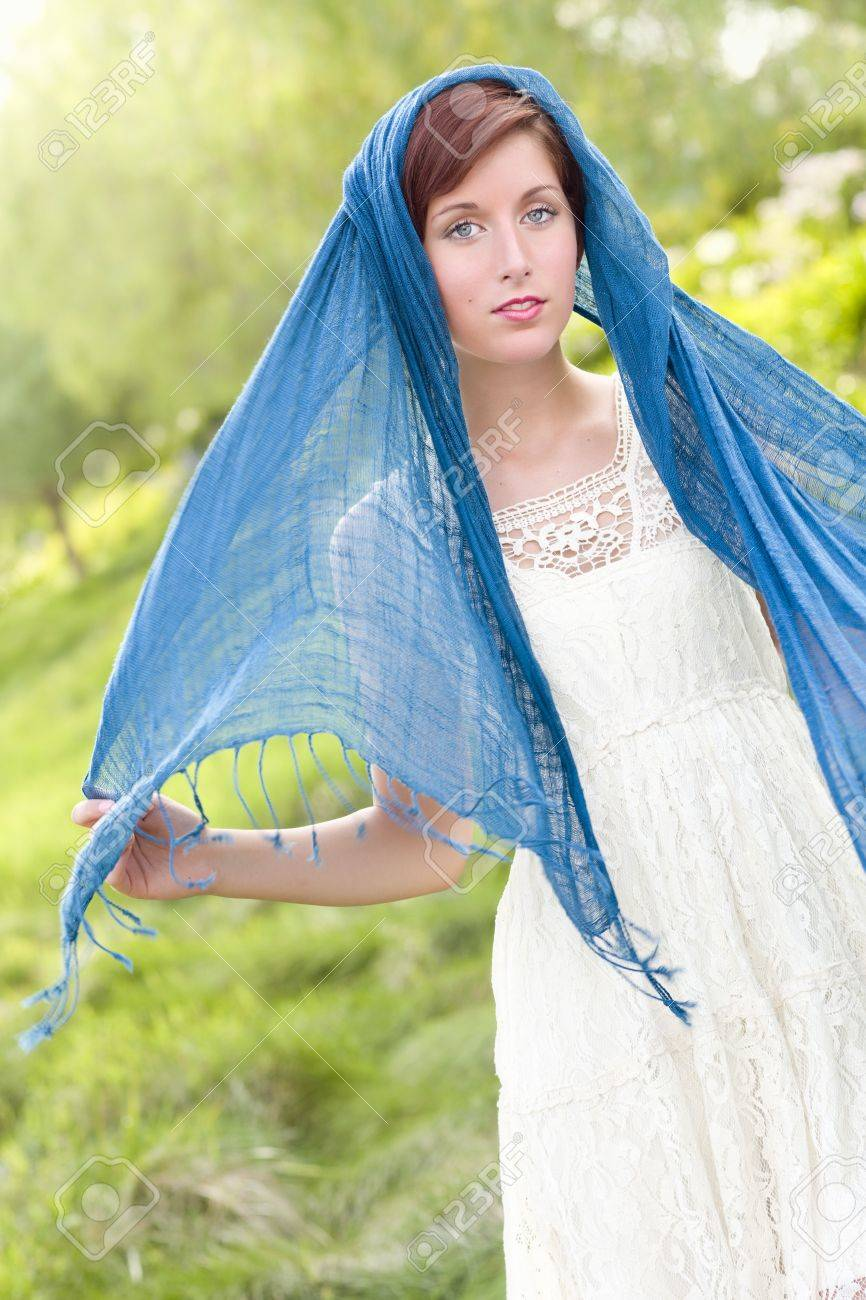 Outdoor Portrait of Pretty Blue Eyed Young Red Haired Adult Female with Blue Scarf. Stock Photo - 10160957