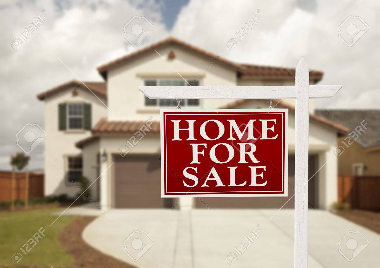 Home For Sale Real Estate Sign in Front of New House. Stock Photo - 10418220