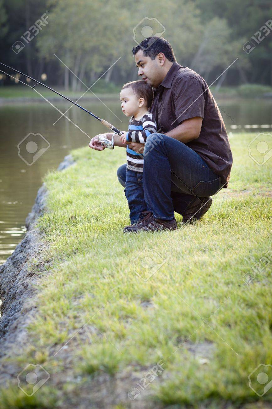 Happy Young Ethnic Father and Son Fishing at the Lake. Stock Photo - 11396007