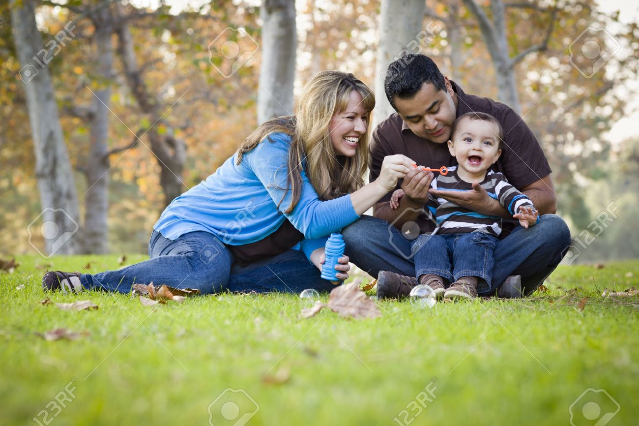 Happy Young Mixed Race Ethnic Family Playing Together with Bubbles In The Park. Stock Photo - 11396041