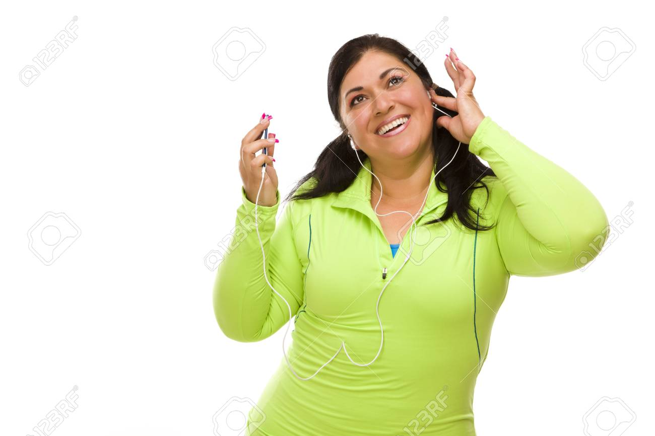 Attractive Middle Aged Hispanic Woman In Workout Clothes with Music Player and Headphones Against a White Background. Stock Photo - 13397850