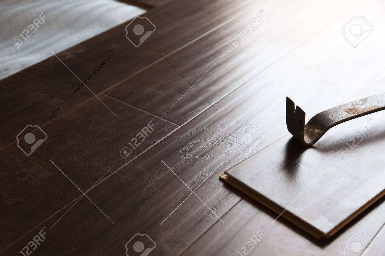 Laminate Flooring Tool Part - 40: Pry Bar Tool With New Laminate Flooring Abstract. Stock Photo - 14203155