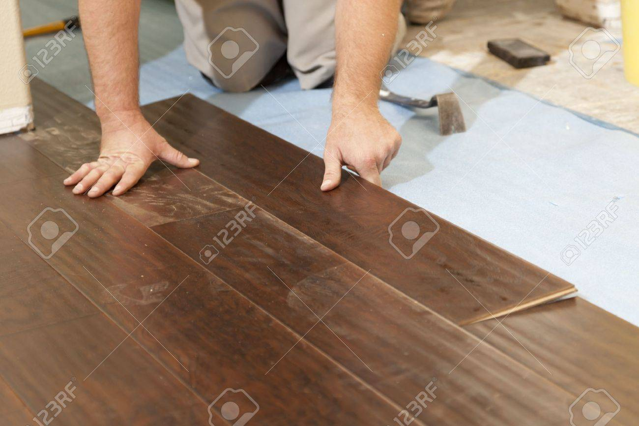 Man Installing New Laminate Wood Flooring Abstract. Stock Photo - 14202735 - Man Installing New Laminate Wood Flooring Abstract. Stock Photo